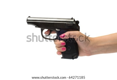 The female hand holds a pistol is isolated on a white background. - stock photo