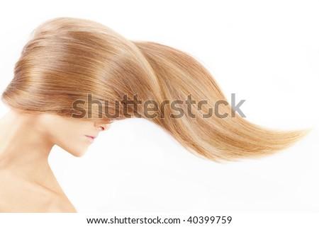 The female head closed by a fair hair, isolated - stock photo