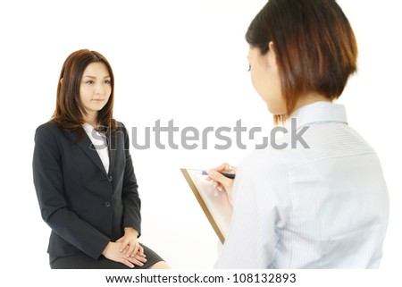 The female office worker who has an interview of the new employee - stock photo