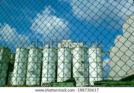 The fence. A metal fence in a factory. - stock photo