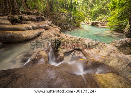 The fifth level of Erawan waterfall in Thailand, natural pond with clear water - stock photo
