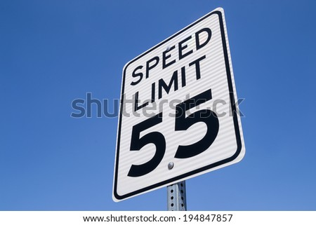 The fifty-five miles per hour street sign in the California sun. - stock photo
