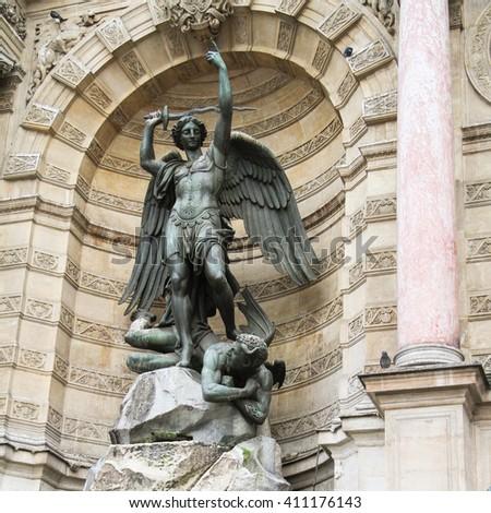 The figure of Saint Michael and the devil by Francisque-Joseph Duret in Paris France - stock photo