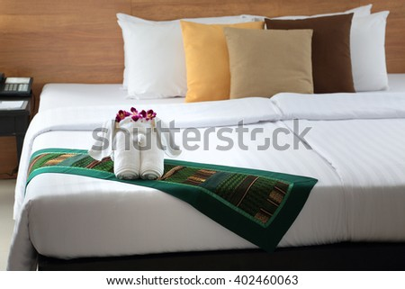 the figure of the elephant from towels on the wide sleeping bed - stock photo