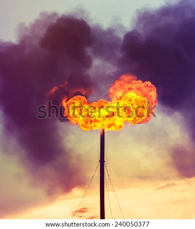 The filled with smoke evening sky from burning of associated gas - stock photo