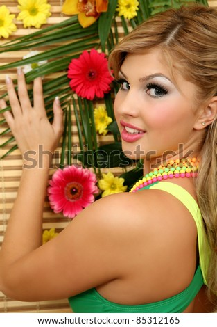 The fine girl and flowers - stock photo