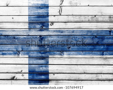The Finnish flag painted on wooden fence - stock photo