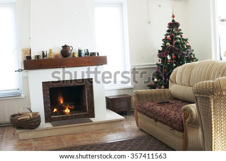 The fireplace and decorated Christmas tree on Christmas. Interior Decorating for Christmas holidays - stock photo