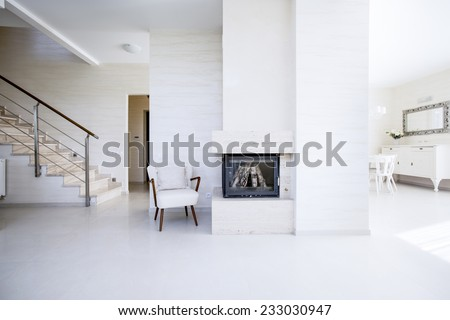 The fireplace in the open space inside the apartment - stock photo
