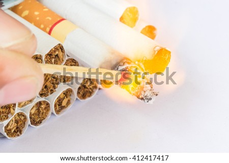 The fires using wood fires ignited by cigarettes. Packaged in an envelope on a white background. - stock photo