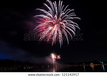 The fireworks display to celebrate Thailand King's Birthday at Suan Luang Rama IX on the auspicious occasion of His Majesty King Bhumibol 85th Birthday Anniversary, 2012. - stock photo