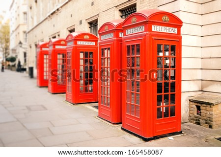 The five red phone boxes in London - stock photo