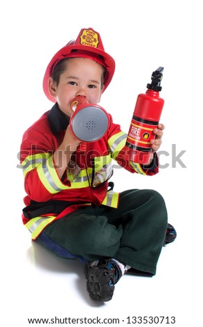 The five-year boy in fireman costume - stock photo