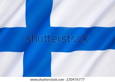 The flag of Finland, also called siniristilippu (Blue Cross Flag), dates from the beginning of the 20th century. It features a blue Nordic cross, which represents Christianity. - stock photo