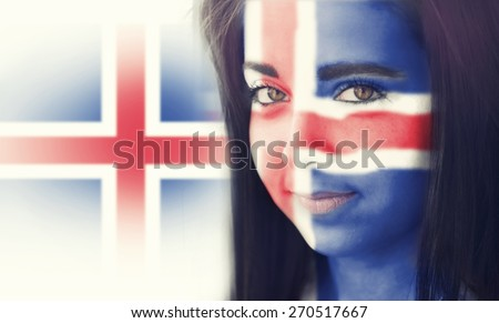 The flag of Iceland on the face of a smiling woman. / Color effects and custom white balance is added to this photo. - stock photo