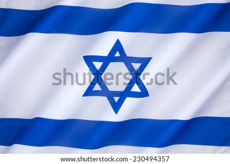 The flag of Israel was adopted on October 28, 1948, five months after the establishment of the State of Israel. The symbol in the center represents the Star of David. - stock photo