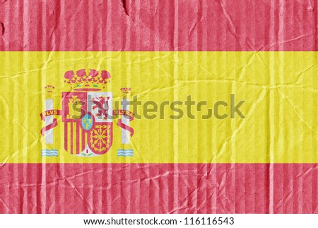 The flag of Spain painted on a cardboard box - stock photo