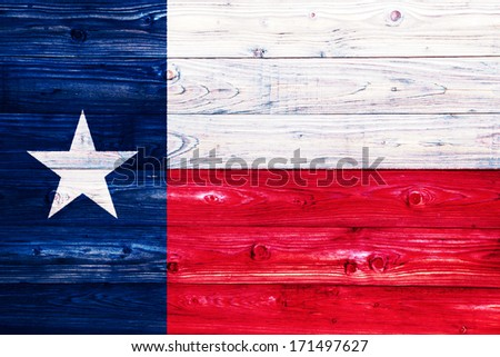 The Flag of the State of Texas on a weathered natural wooden surface close-up - stock photo