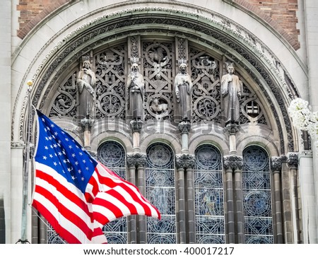 The flag waving in front of St Bart's Episcopal Church in New York City. - stock photo