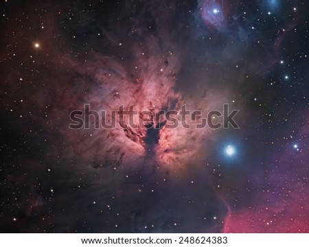 The Flame Nebula - is an emission nebula about 1,500 light years away in the constellation Orion. It is part of the Orion Molecular Cloud Complex that includes the famous Horsehead Nebula. - stock photo