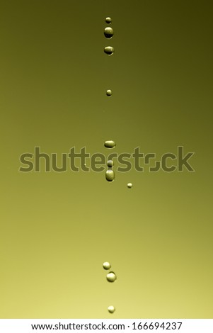 The fluid motion of water splashing as it is poured.  - stock photo