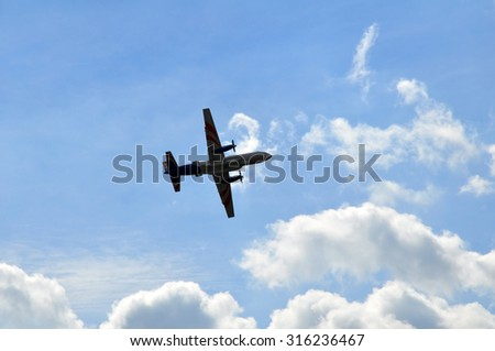 The flying plane - stock photo