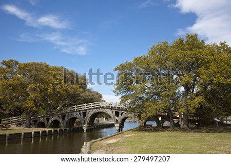 The footbridge in Corolla in Heritage Park is on the National Register of Historic Places. - stock photo