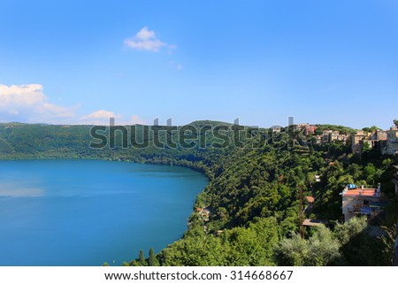The forested shores around the small, volcanic Lake Nemi from Castel Gondolfo, Italy - stock photo
