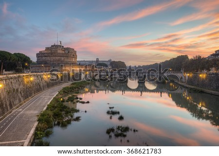 The fortress of Sant'Angelo (Castel Sant'Angelo) and bridge over river Tiber (Fiume Tevere) at a spectacular sunrise, Rome, Italy, Europe - stock photo