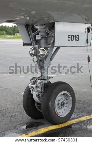 The forward undercarriage of the modern plane - stock photo