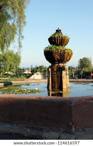 The fountain in front of Mission Santa Barbara in California USA - stock photo