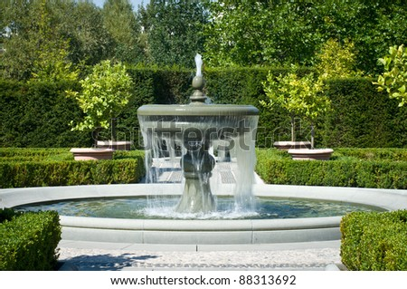 The fountain in the garden in the style of renaissance. - stock photo