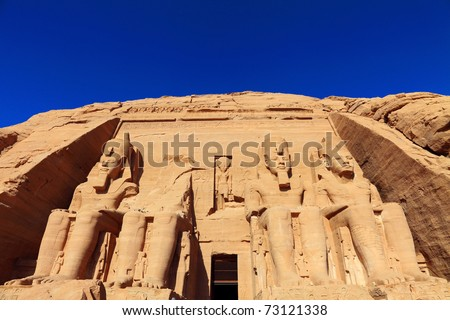 The four figures carved in the rock of Ramses, Egypt. - stock photo