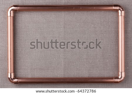 The frame is made from copper water pipes. - stock photo