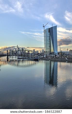 The Frankfurt Skyline behind the Deutschherrnbruecke (Railway Bridge) with the new European Central Bank HQ under construction. - stock photo