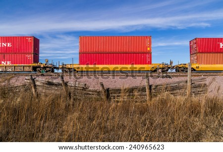 The freight cargo containers in the Midwest afternoon light. - stock photo