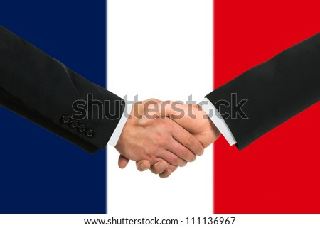 The French flag and business handshake - stock photo