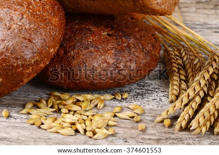 The fresh bread with ears of rye - stock photo