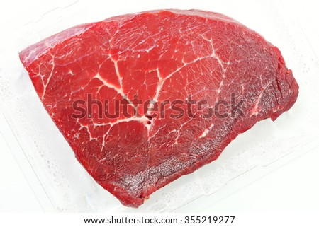 The fresh cow beef in food grade transparent packaging represent the food raw material and meat concept related idea. - stock photo
