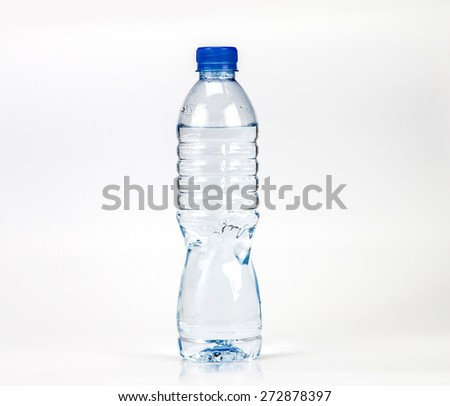 The fresh drink water bottle with small water condense drop inside bottle head on white background - stock photo