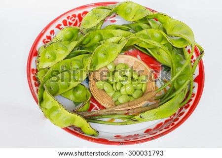 The fresh Parkia is tropical stinking edible beans in weave basket on tray zinc coating vintage - stock photo