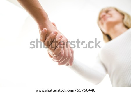 The friendly businesswoman  keeps women's hands in greeting when meeting - stock photo