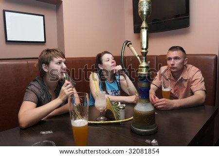 The friends resting in a Arabic cafe - stock photo