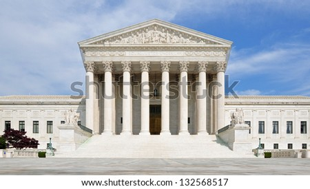 The front facade of the United States Supreme Court in Washington DC, USA. - stock photo