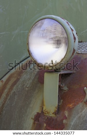 The front headlight of an military truck - stock photo
