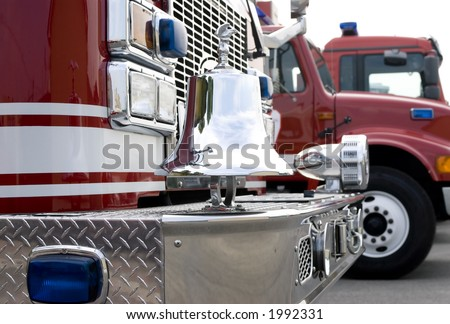 The front of a fire truck with chrome trim and bell - stock photo