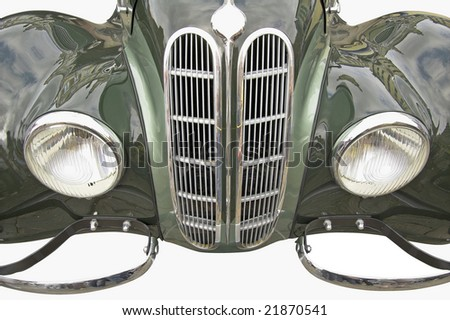 The front of antiquarian car isolated over white with clipping path. - stock photo