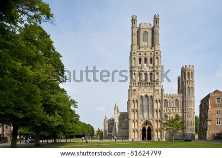 The front of the beautiful Ely Cathedral with trees - stock photo