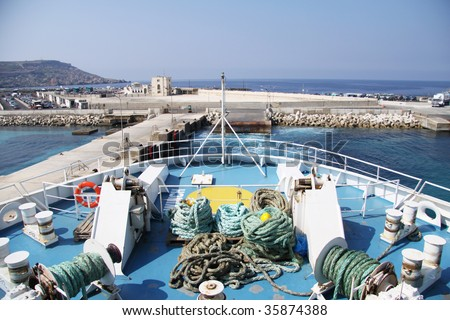 the front part of a passenger and car vessel leaving port - stock photo