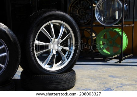 The front tire on the car repair shop - stock photo